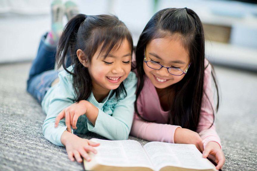 2 girls reading bible
