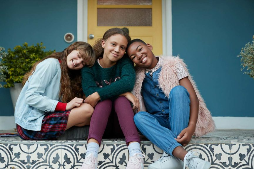 3-happy-girls-relaxing-on-porch