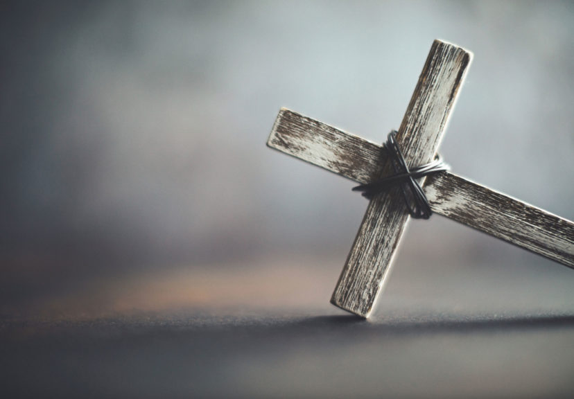 Cross in rustic setting. Religious background with copy space