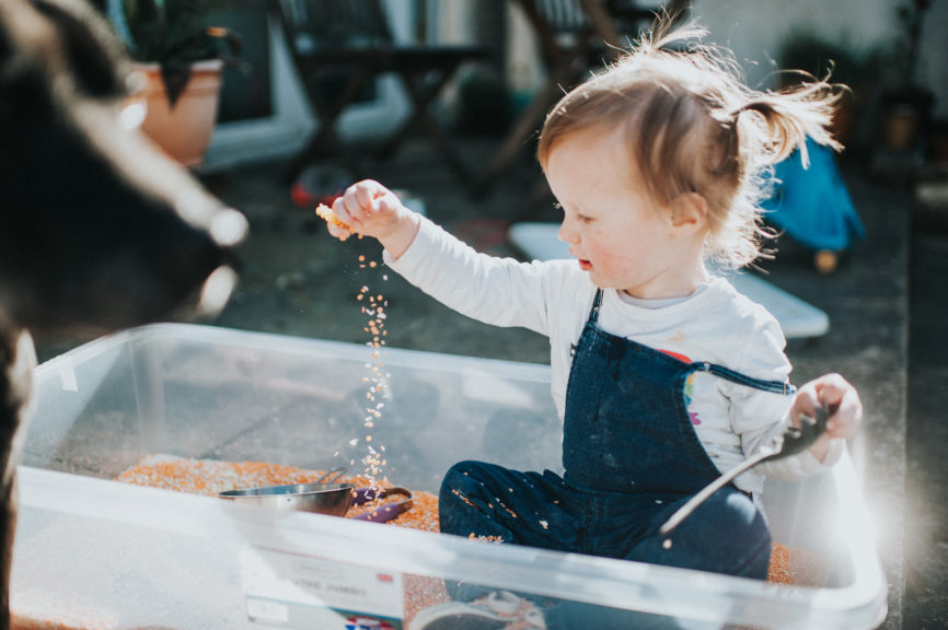 Cute little girl playing with sensory equipment