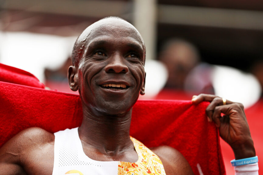 Eliud Kipchoge of Kenya celebrates after he crosses the line
