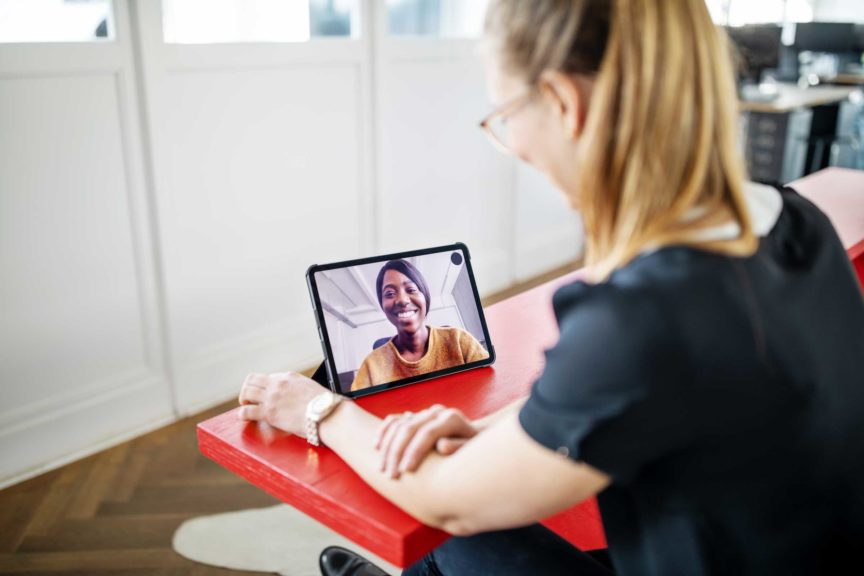 Female executives having video call in office