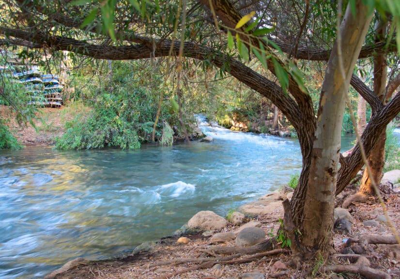 Flowing-stream-of-the-Jordan-River-in-Israel