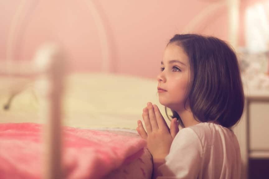 Little girl saying her bedtime prayers