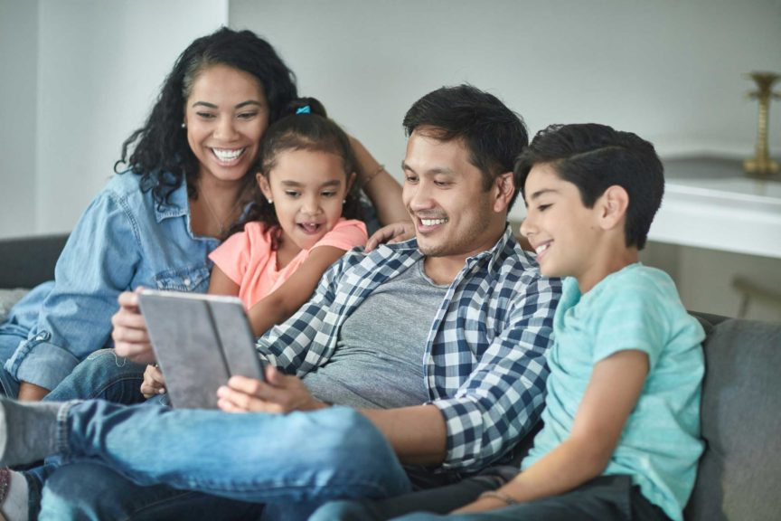Multi-ethnic family taking selfie on digital tablet