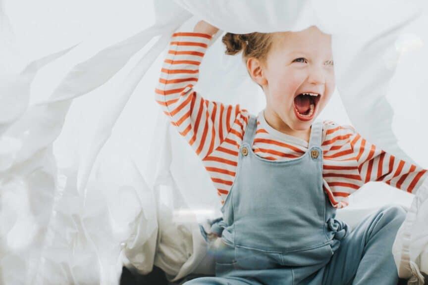 Playful Girl under a White Sheet