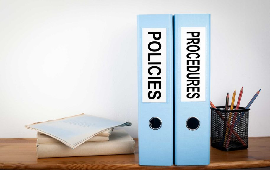 Policies and Procedures binders in the office