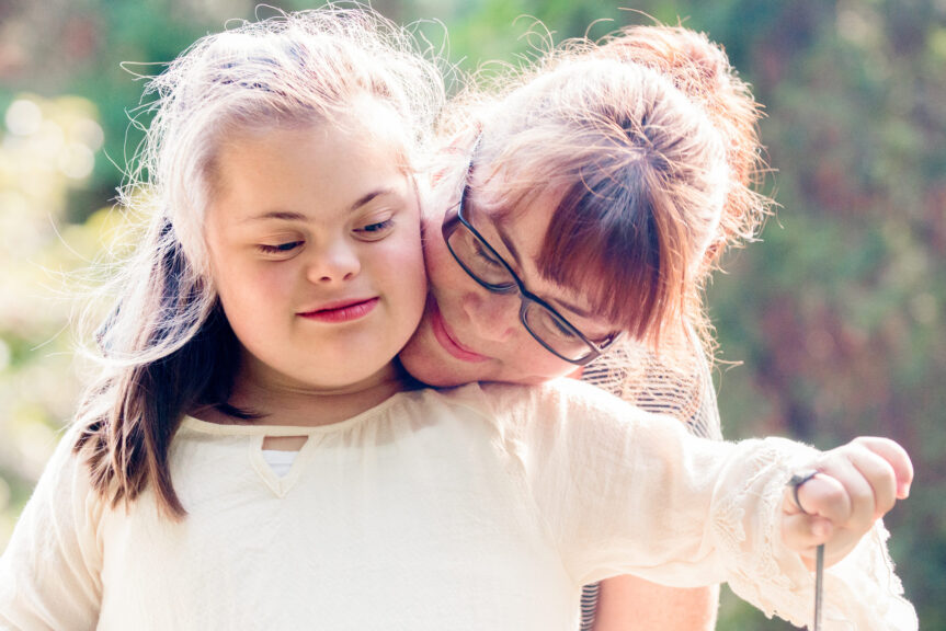 Portrait-of-mother-with-her-daughter-of-12-years-old-with-Down-Syndrome