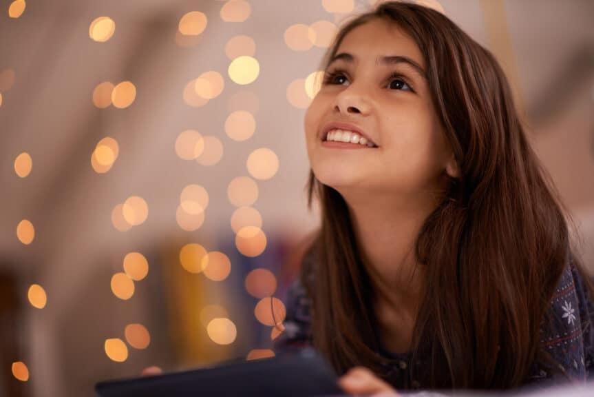 Shot of a cute little girl using a digital tablet