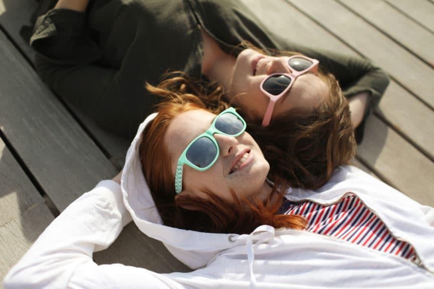 Two young women enjoying on the beach