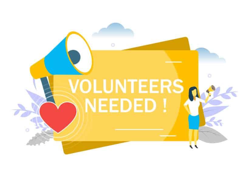 Volunteers needed, woman speaking through megaphone