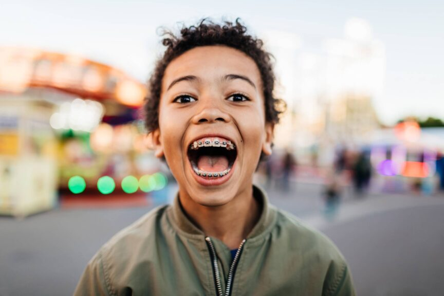 Young Boy With Mouth Wide Open At Fun Fair
