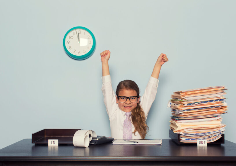 Young-Girl-Businesswoman-Raises-Arms-at-Office-Desk
