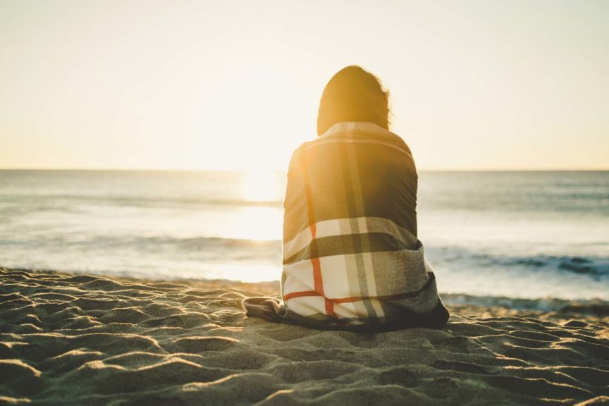 beach-sunset-woman-blanket