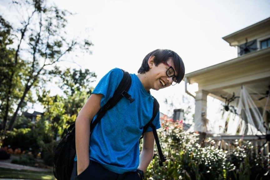 boy-laughing-outside-school