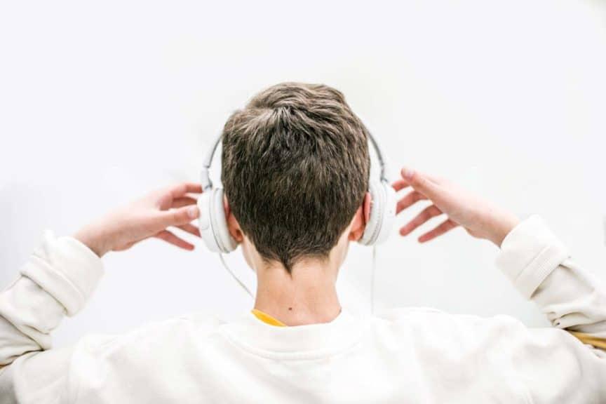 boy listening music with headphones indoor