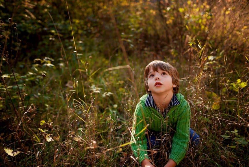 boy sitting in field