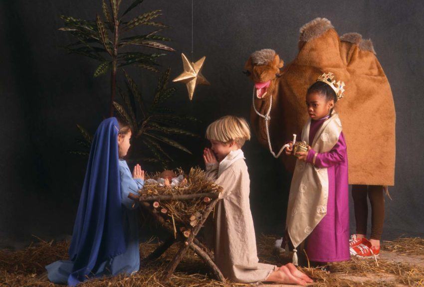 Diverse children acting in nativity scene