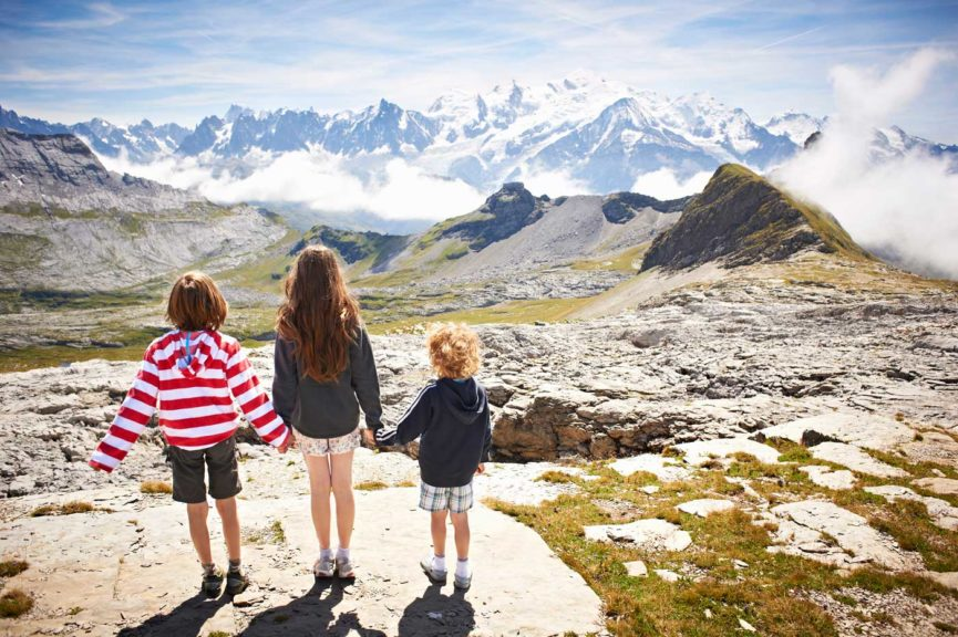 Children standing in rocky landscape