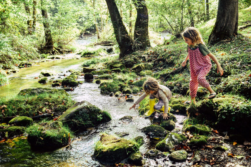 climbing-and-stepping-in-a-river-exploring-a-beautiful-natural-area