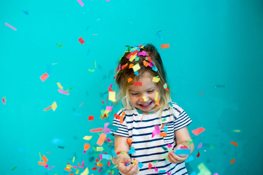 Colorful confetti falling on girl