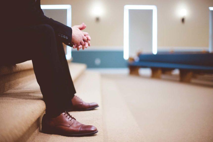 Elegant man on church stairs