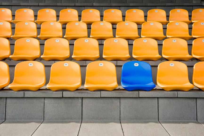 Empty stadium seats orange and blue