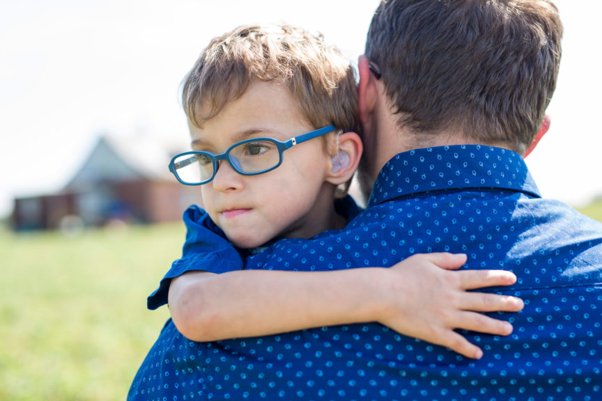 Father And Son Hugging On Outdoor summer
