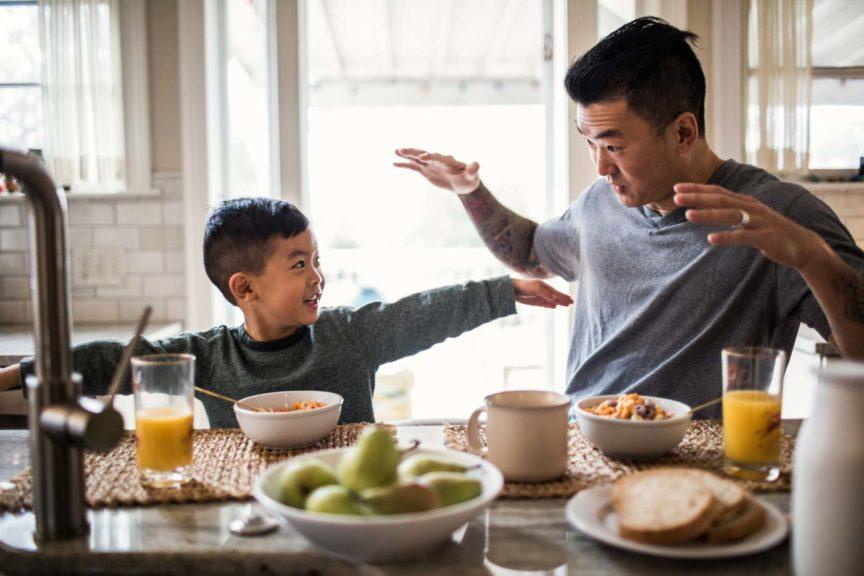 father-son-talking-breakfast-table
