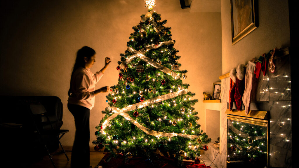 girl-christmas-tree-fireplace-decorations-standing