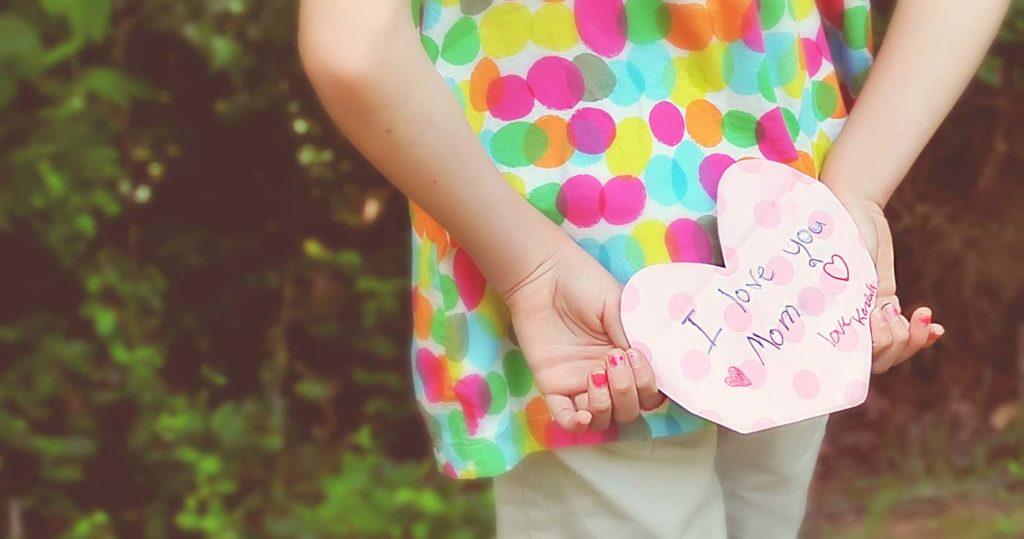 girl holding letter