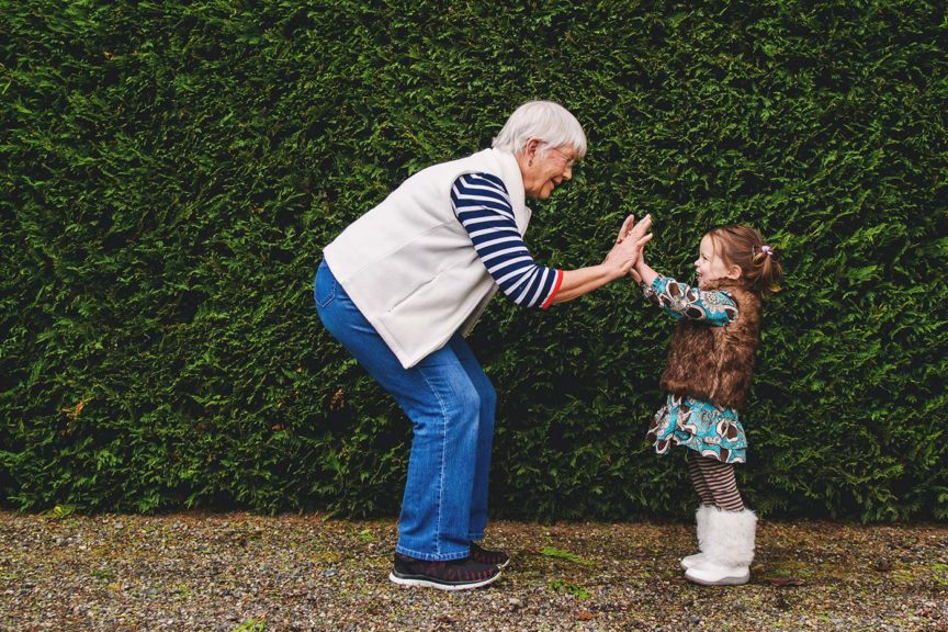 girl playing with grandmother volunteer excitement