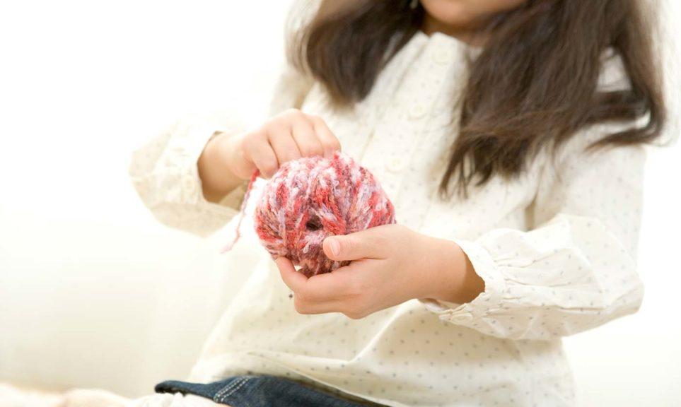 girl holding yarn kids bible memory verse game
