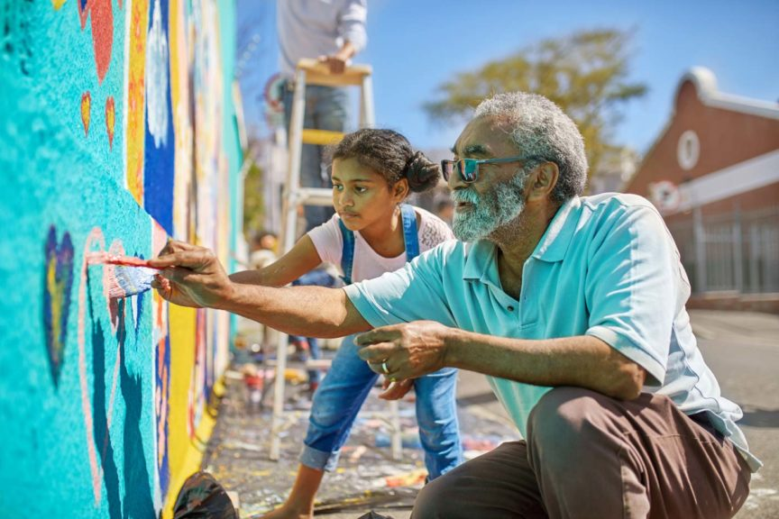 grandfather-granddaughter-painting-mural-urban-wall