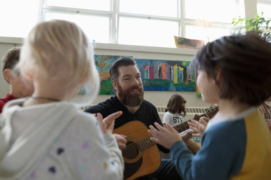 teacher with guitar school