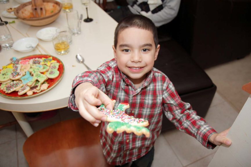 Happy Boy Offering Christmas Cookie
