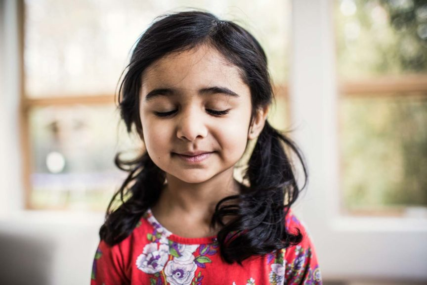 Portrait of hopeful young girl at home