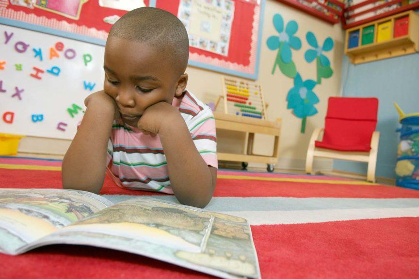 kid reading on floor