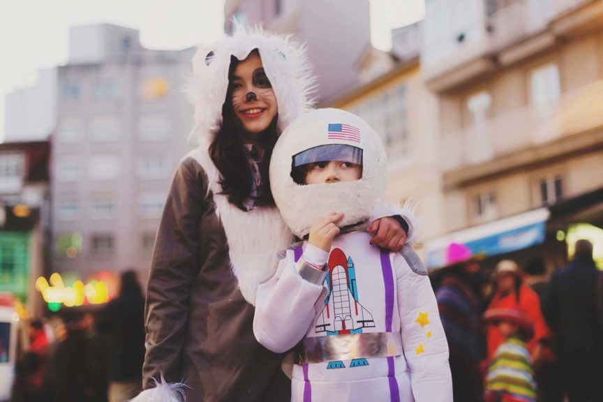 Two kids dressed up in halloween costumes as Astronaut and wolf