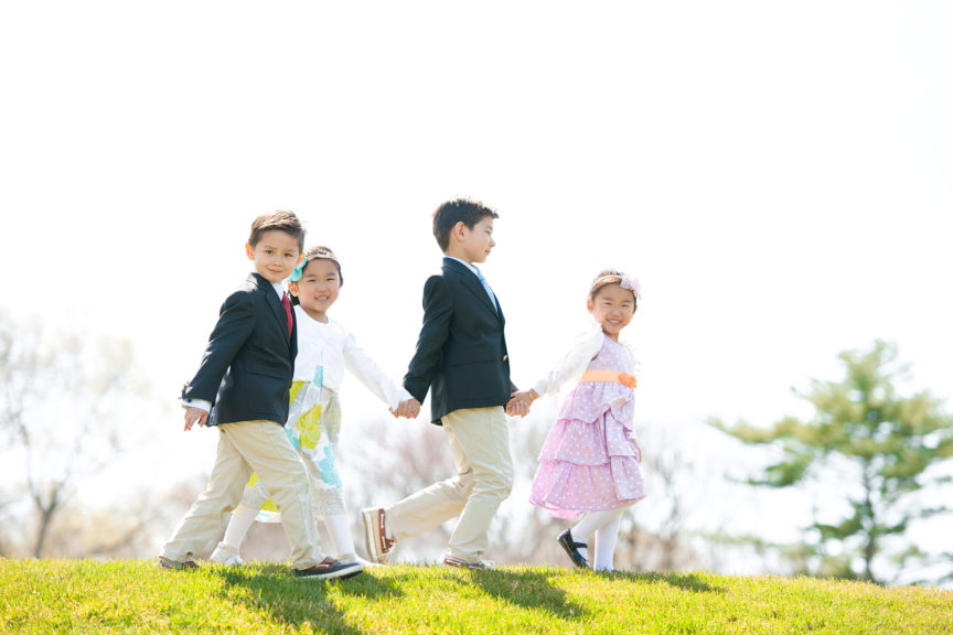 Kids walking hand in hand Easter clothing