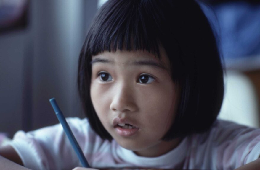 little-girl-writing-looks-concerned-worried
