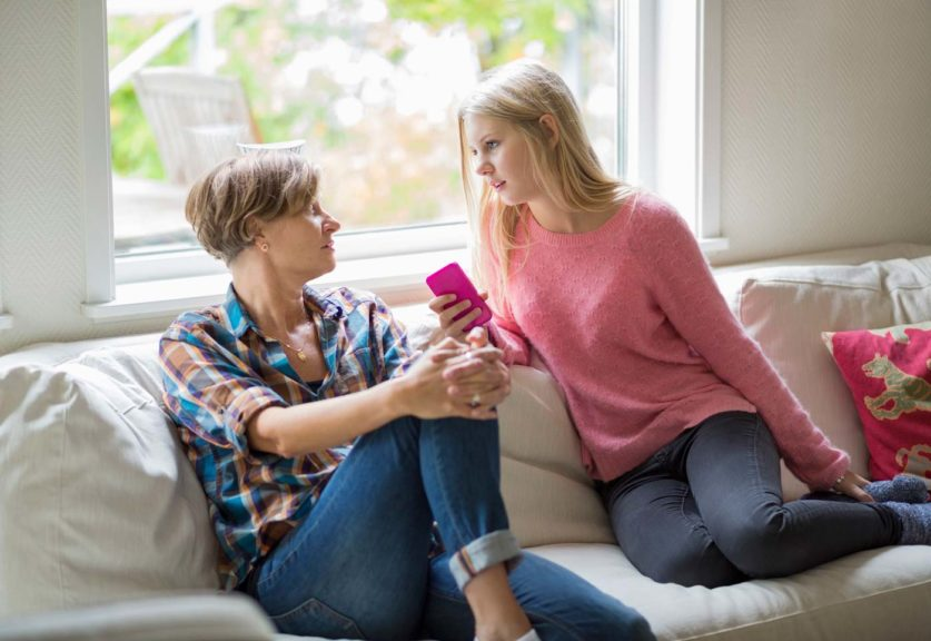 mother-daughter-talking-sofa