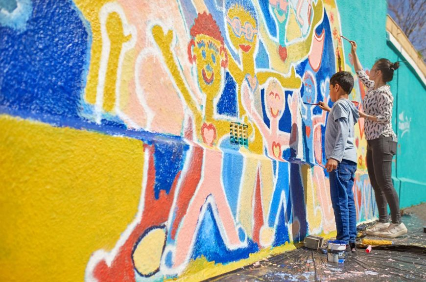 mother-son-volunteer-painting-mural-wall