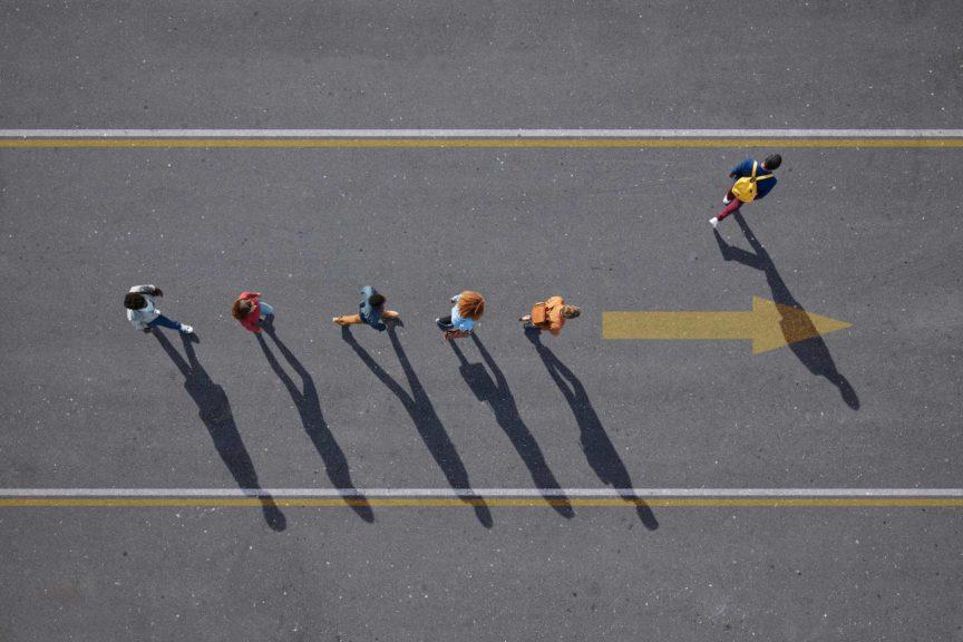 People walking in line on road, painted on asphalt, one person walking off