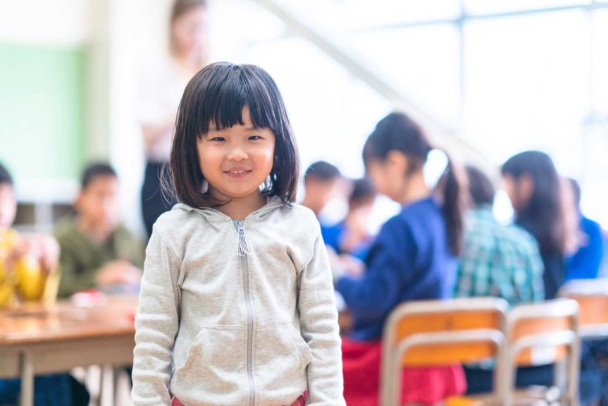 Portrait of cute little girl in classroom