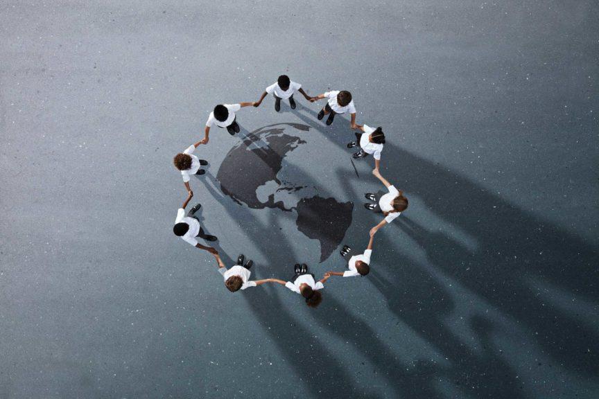 School children in uniforms standing in circle & holding hands