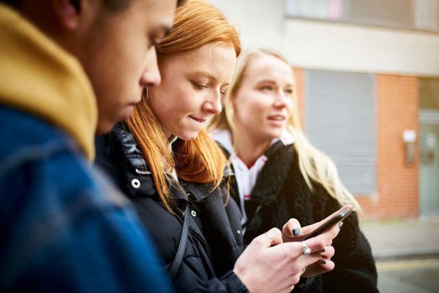 teenage girl checking phone