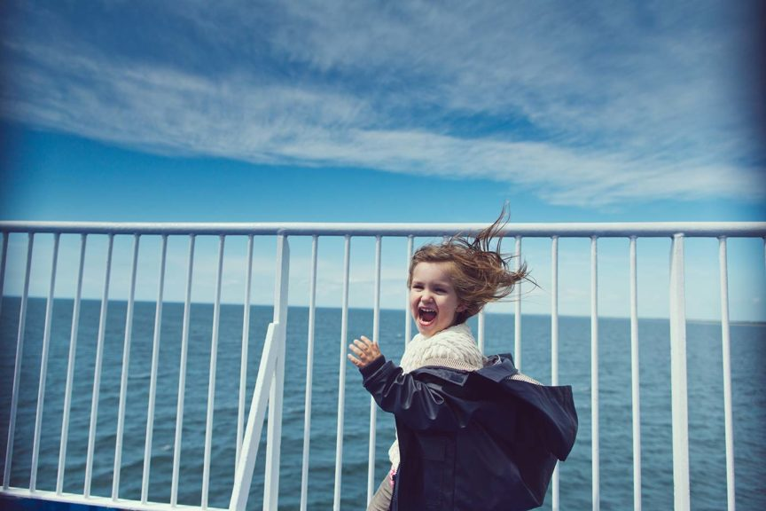 Girl running on ferry deck