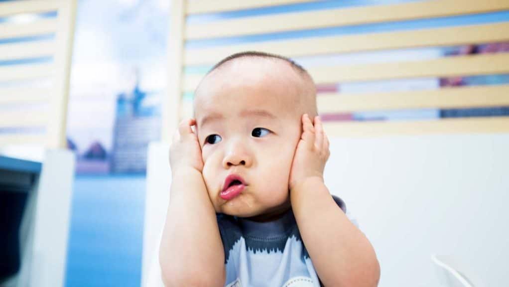 upset-baby-hands-head