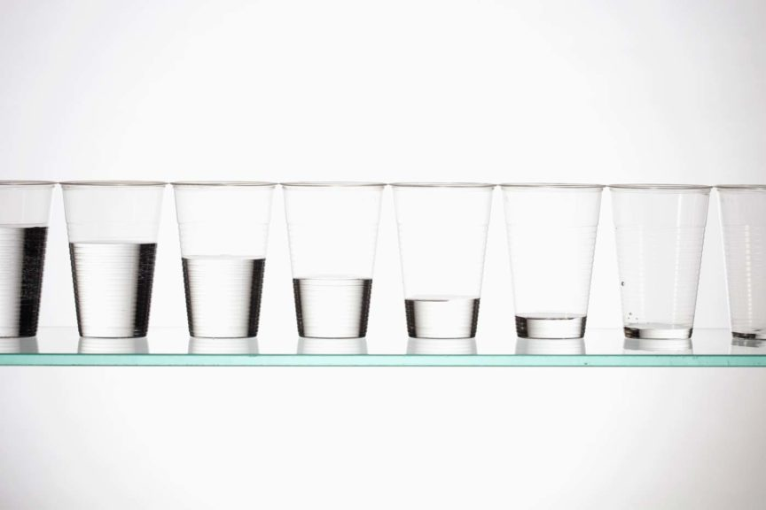 A row of glasses with varying amounts of water